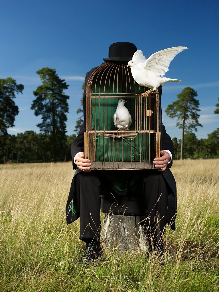 Mann mit Tauben